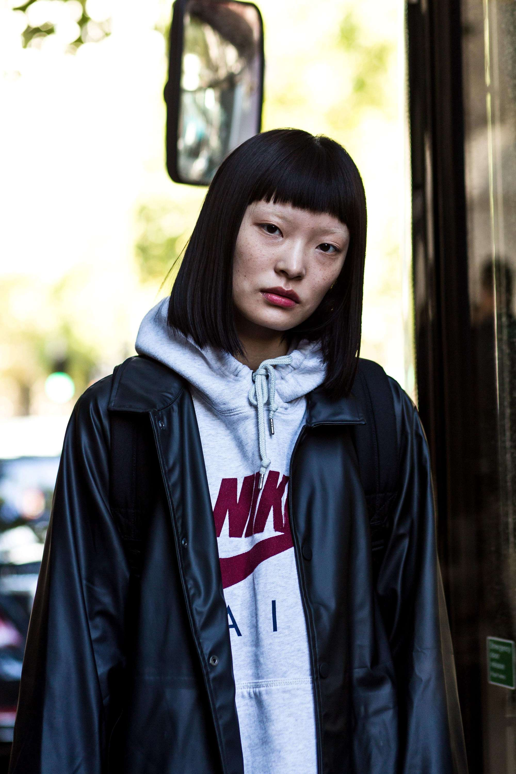 short asian hairstyles: street style star with medium bob with a fringe hairstyle