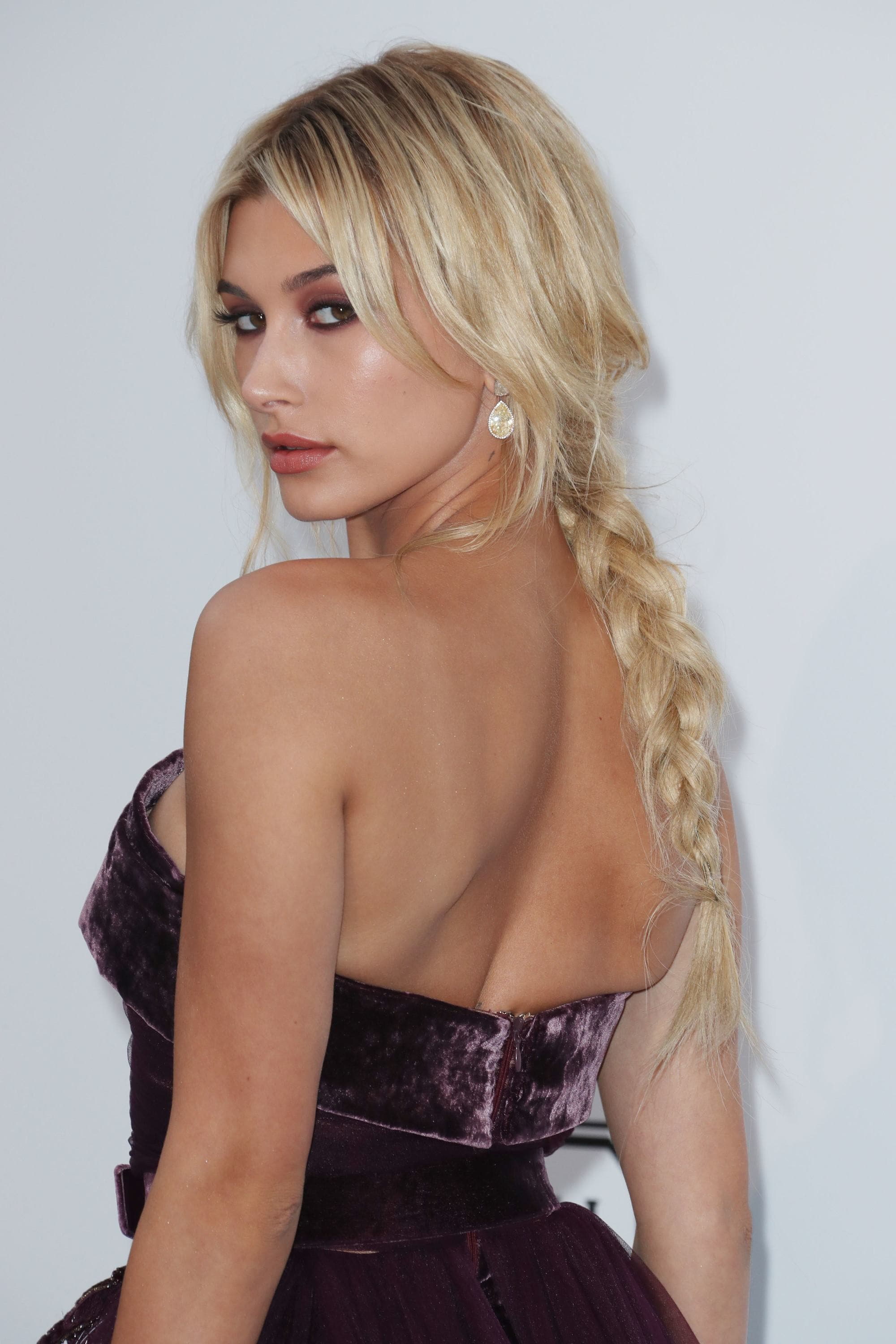 easy braids for long hair: hailey baldwin with braided ponytail on the amfar gala red carpet