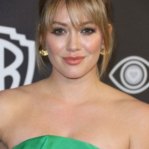 7 Flattering Ways To Pull Off Bangs For Round Face Shapes