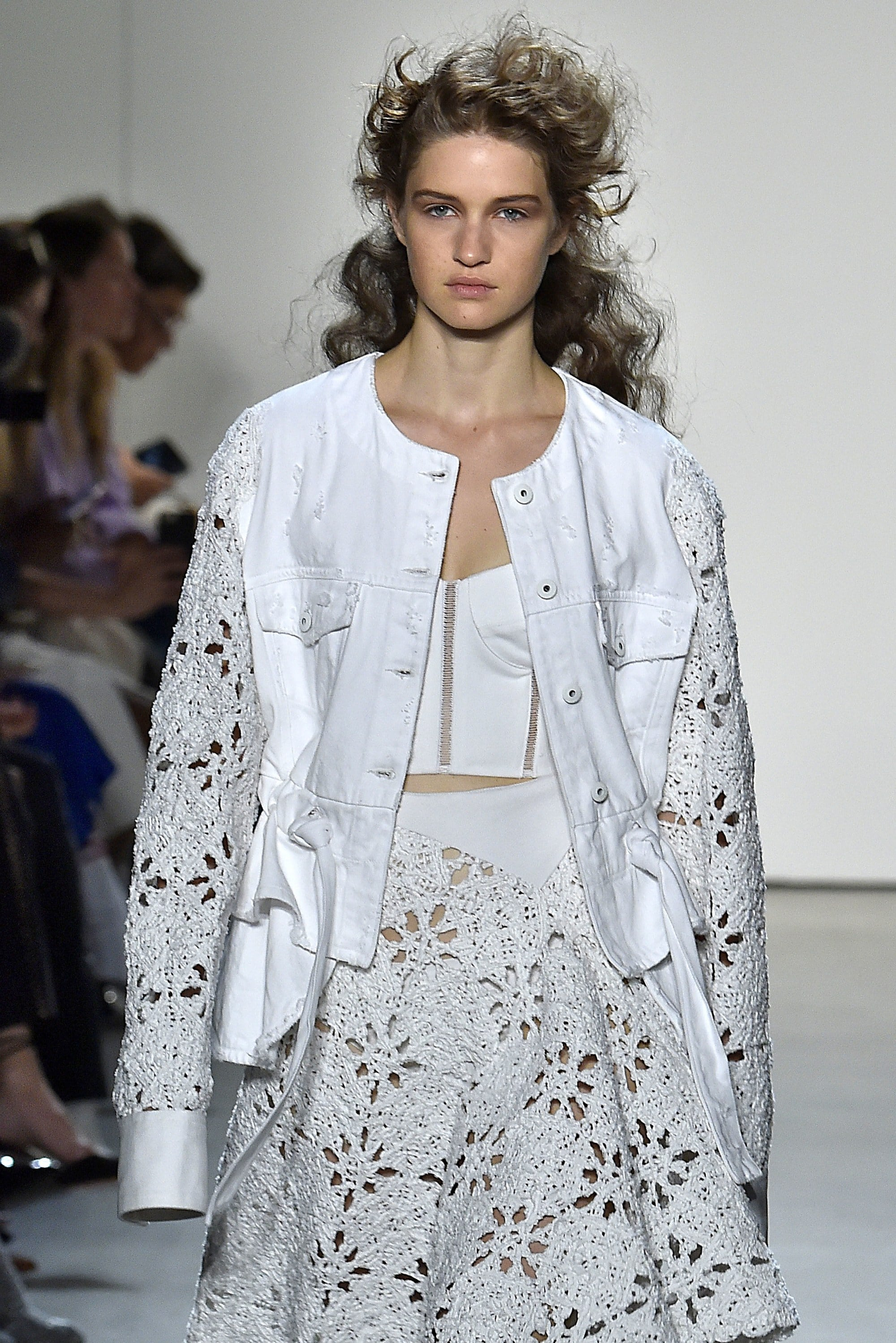 brunette model at the jonathan simkhai nyfw ss18 show with untamed curly hair