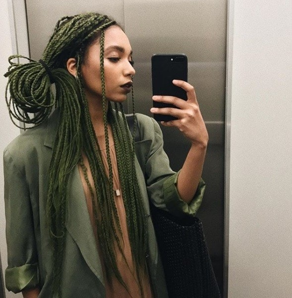shot of woman with green ponytail box braids undone, shot in the lift