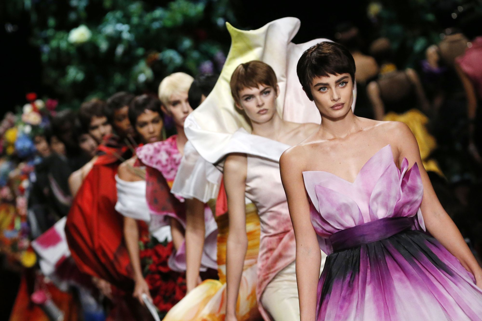 milan fashion week: moschino spring/summer 2018 runway with models wearing fairy tale costumes with pixie cut wigs