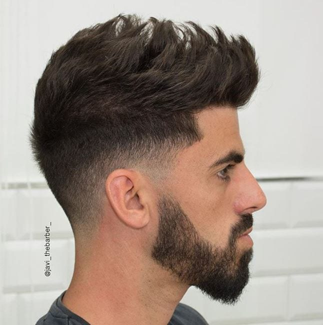 side view of quiff hairstyle with shadow taper finish