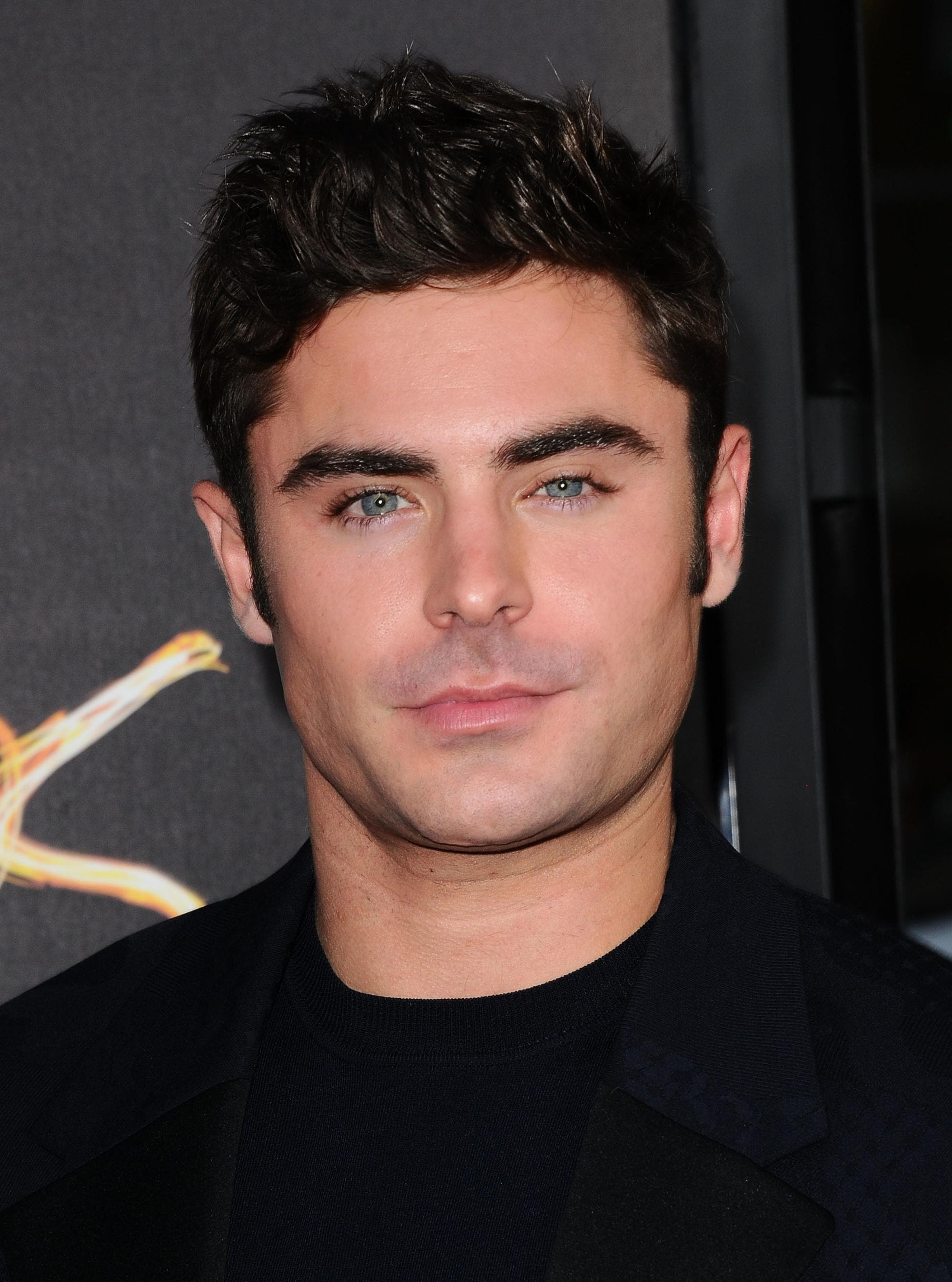 zac efron with dark spiked up quiff hair