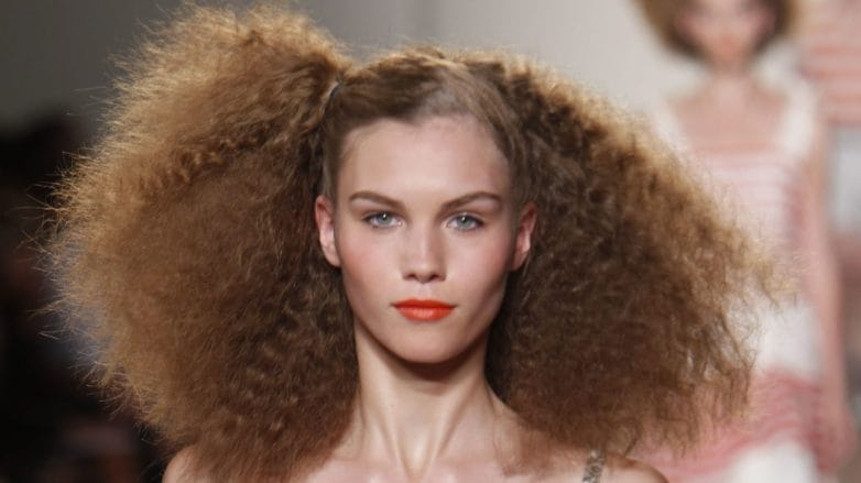 Marc Jacobs SS11 model with brown frizzy hair with side parting on catwalk