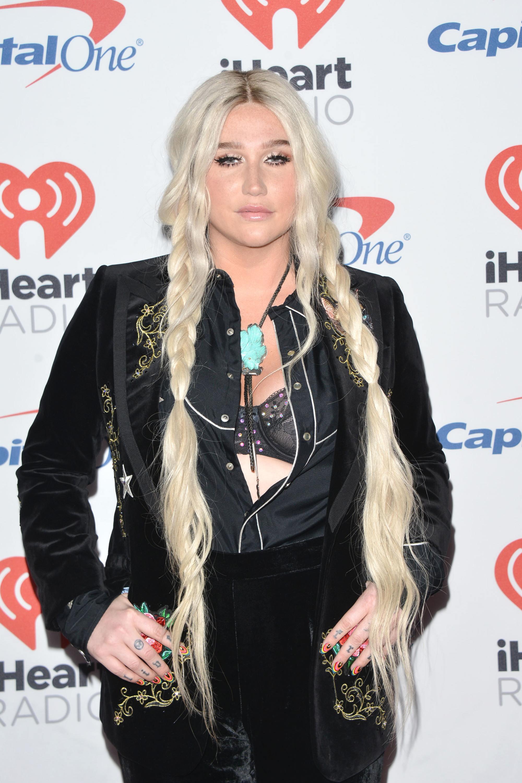 Kesha long platinum blonde hair in pigtail braids