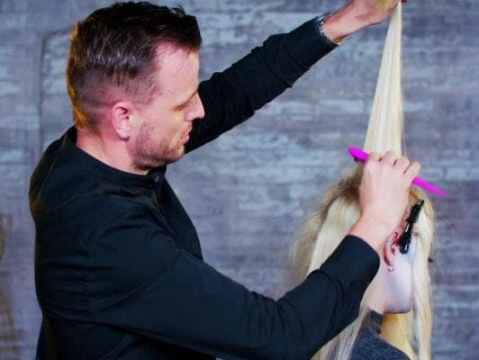 Superdrug loves scream queen halloween hair tutorial: shot of model getting her hair backcombed with a back comb brush by Unilever hair stylist Dan Lynes