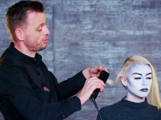 Superdrug loves scream queen hair halloween tutorial: shot of Unilever hair stylist Dan Lynes creating waves on models hair