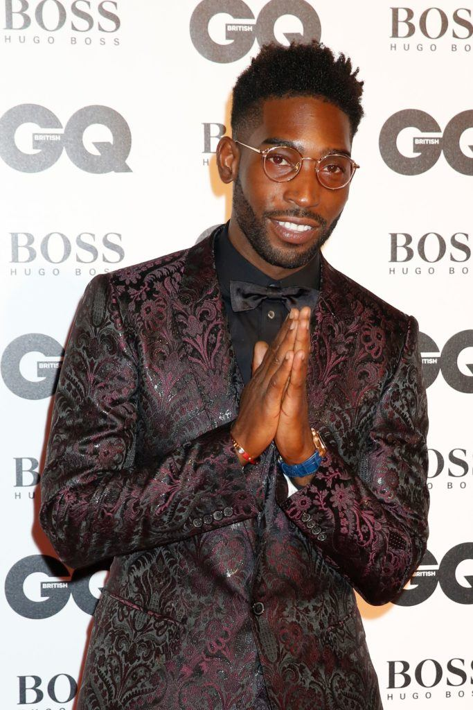 shot of tinie tempah on the GQ Men of the Year Awards red carpet wearing suit, with his hair styled into a high top fade