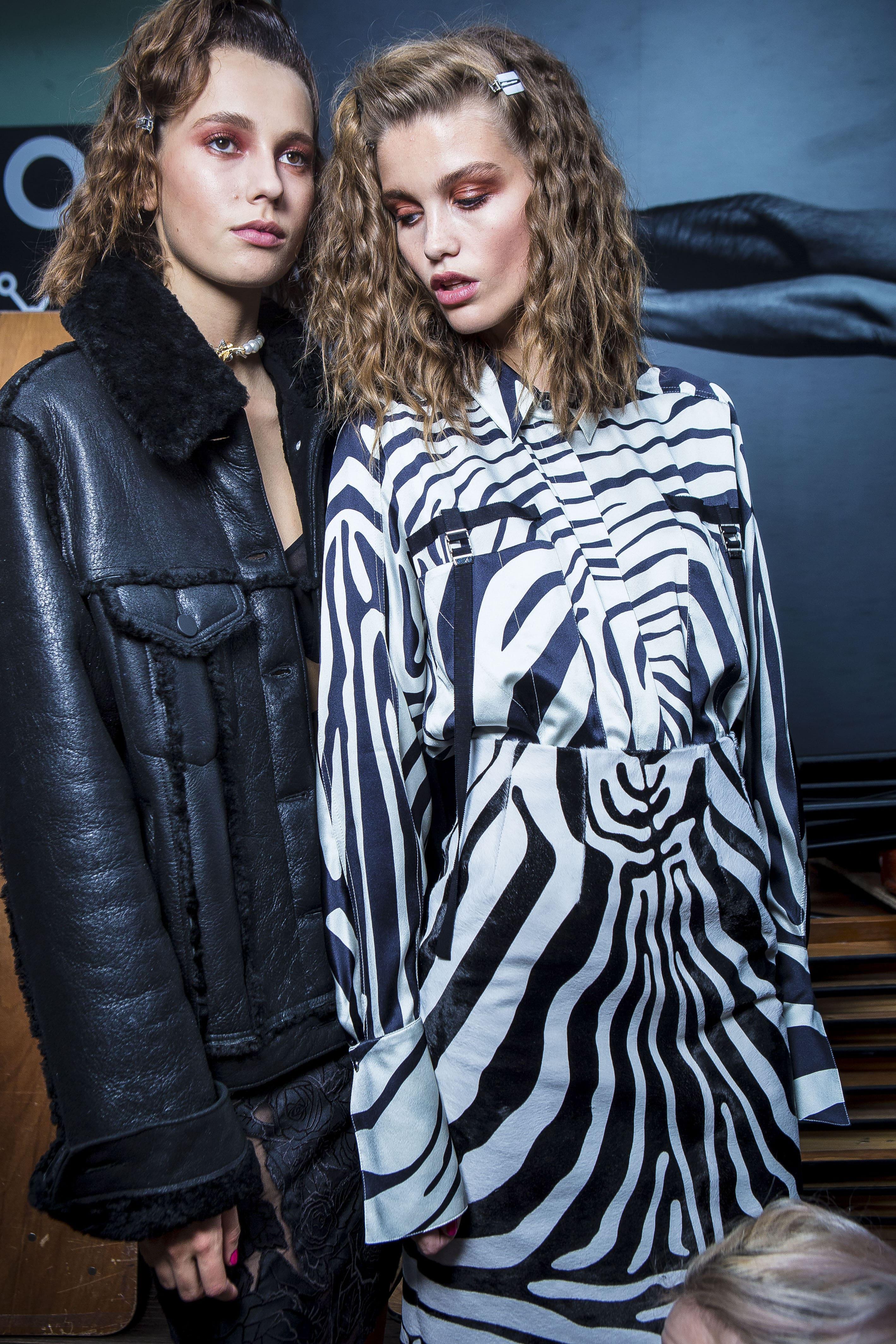 models backstage at runway show