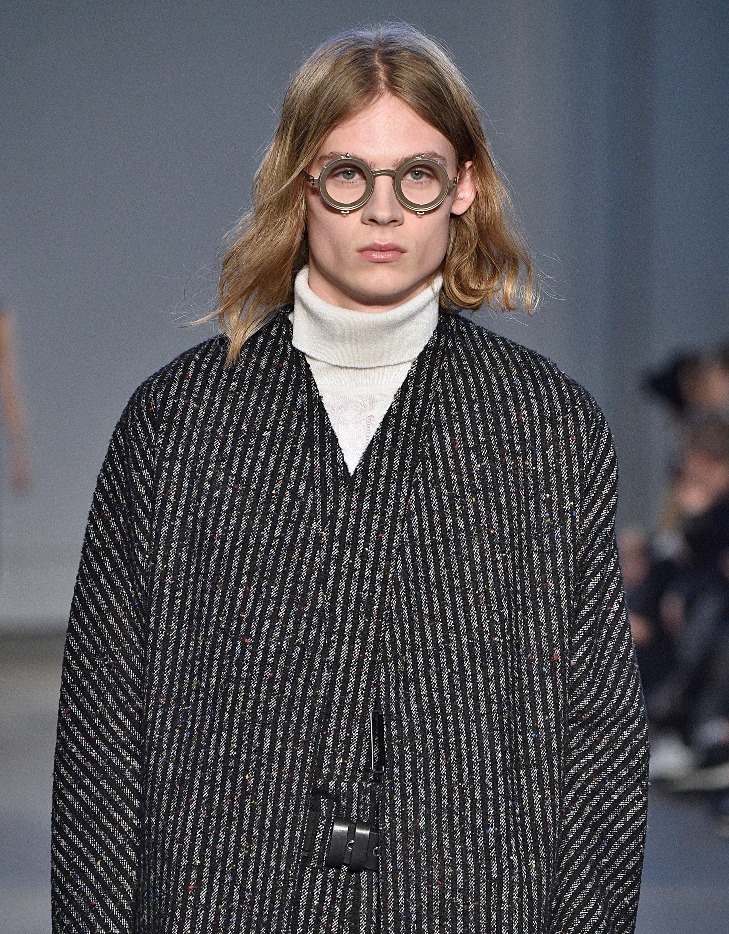 blonde male model with long flowing '90s kurt cobain hair