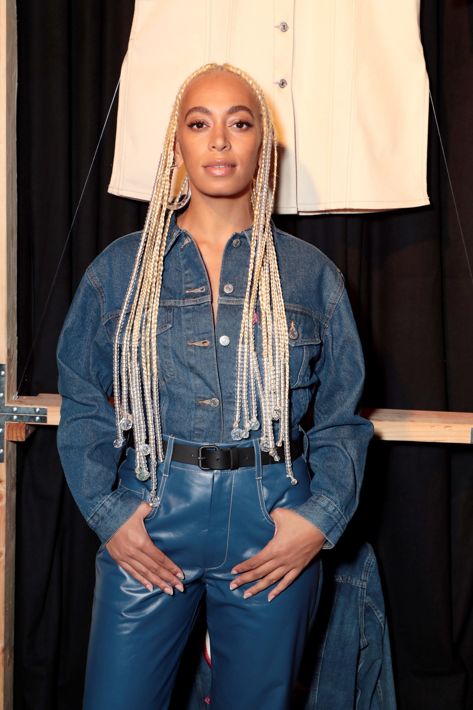 shot of solange knowles with platinum box braids with loose ends that have chandelier hair accessories, at levi's anniversary