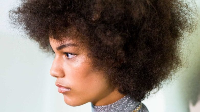 side profile of model with type 4 afro hair