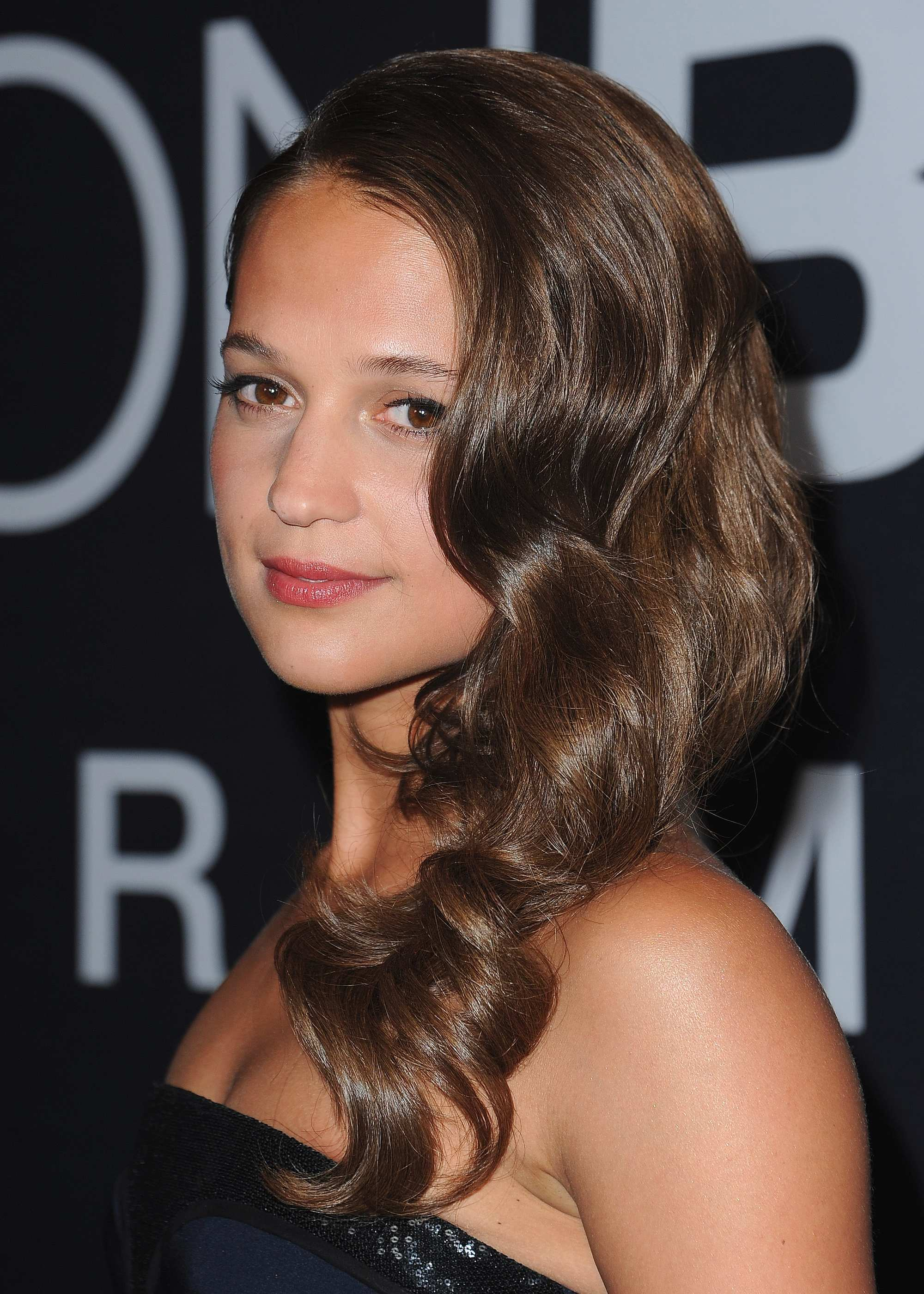 swedish actress alicia vikander at the Las Vegas premiere for jason bourne with glamorous hollywood waves in her hair