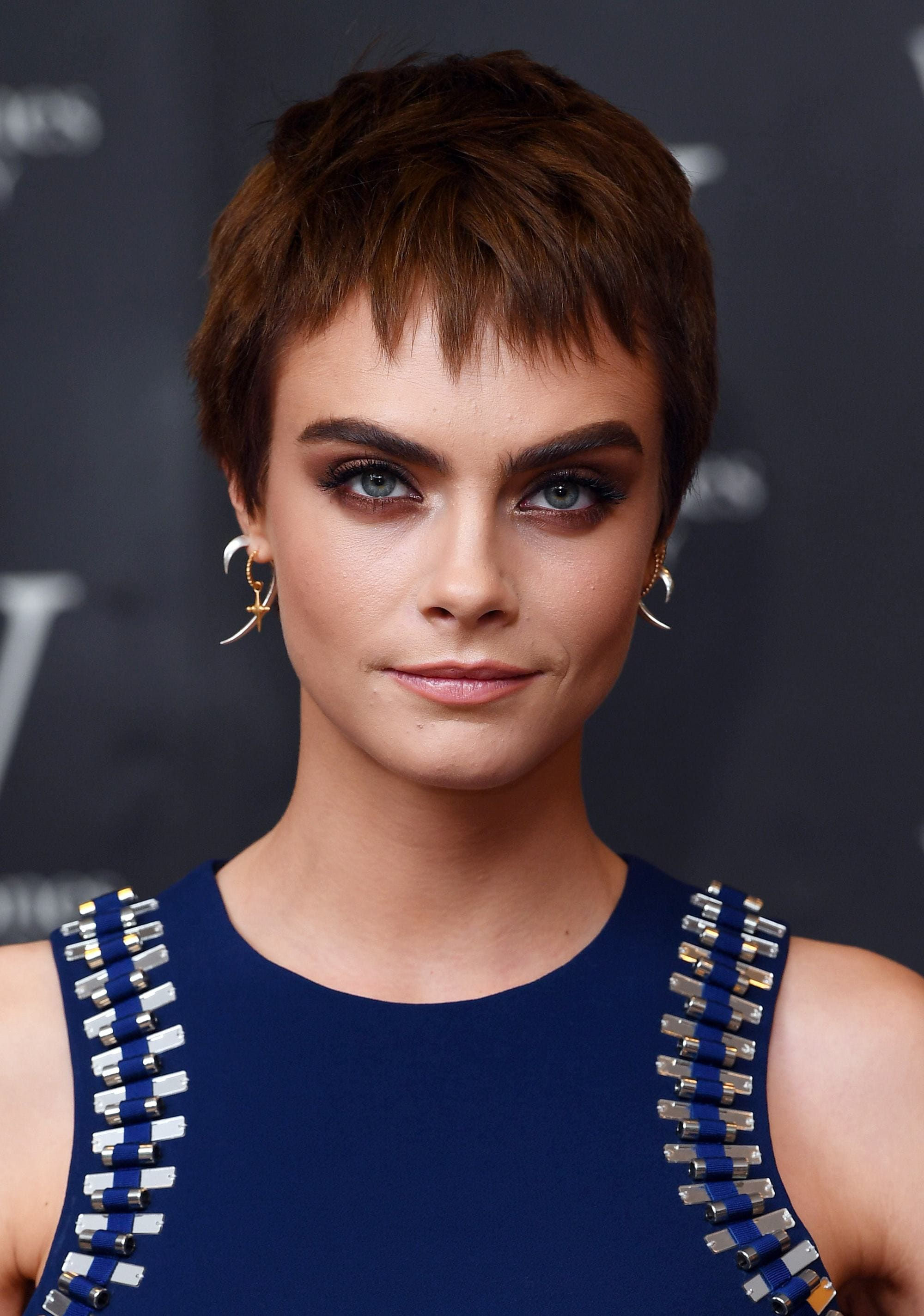 model cara delevingne at her debut book launch with chocolate brown pixie hair