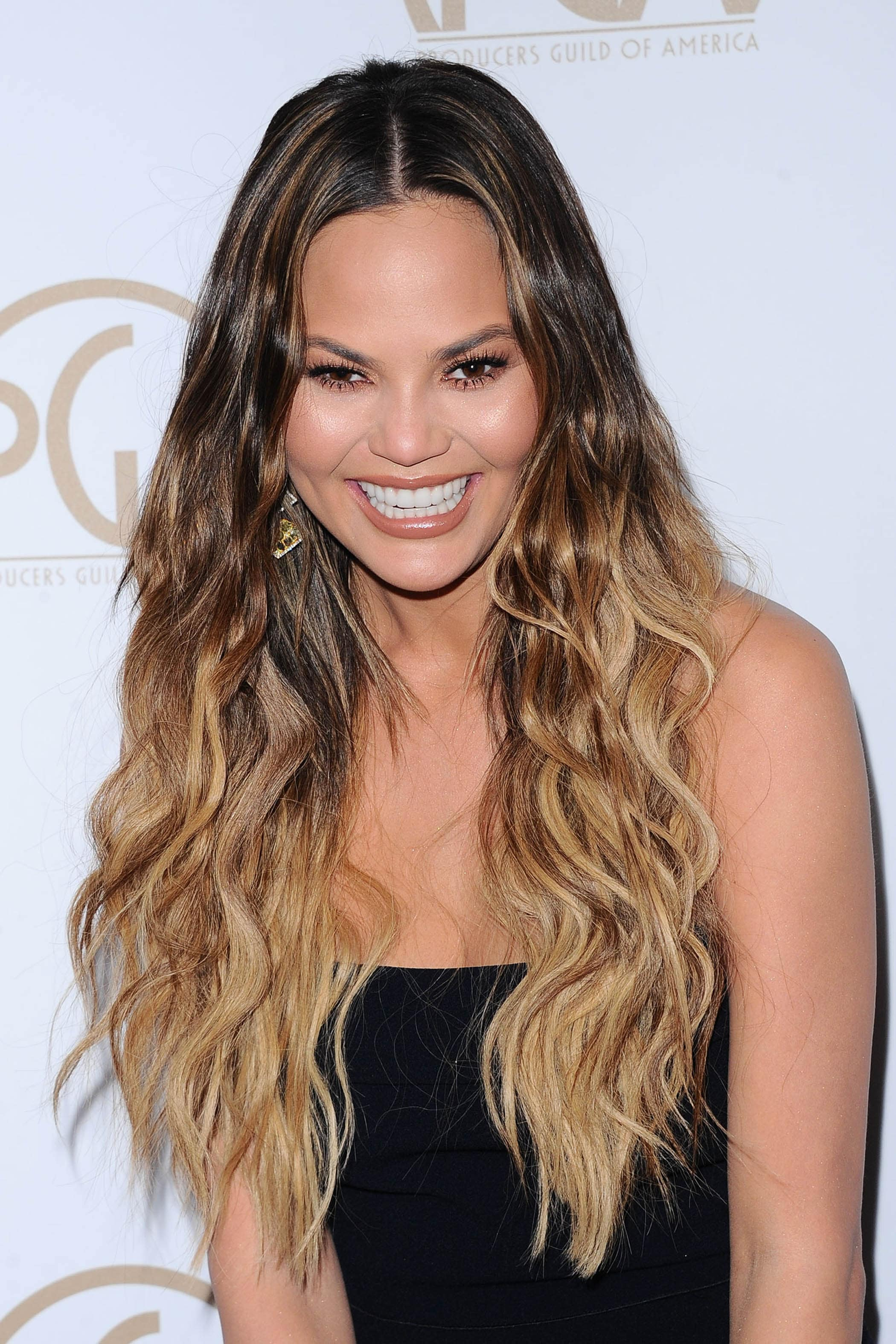model chrissy teigen with long mermaid waves and flomboyage hair colour