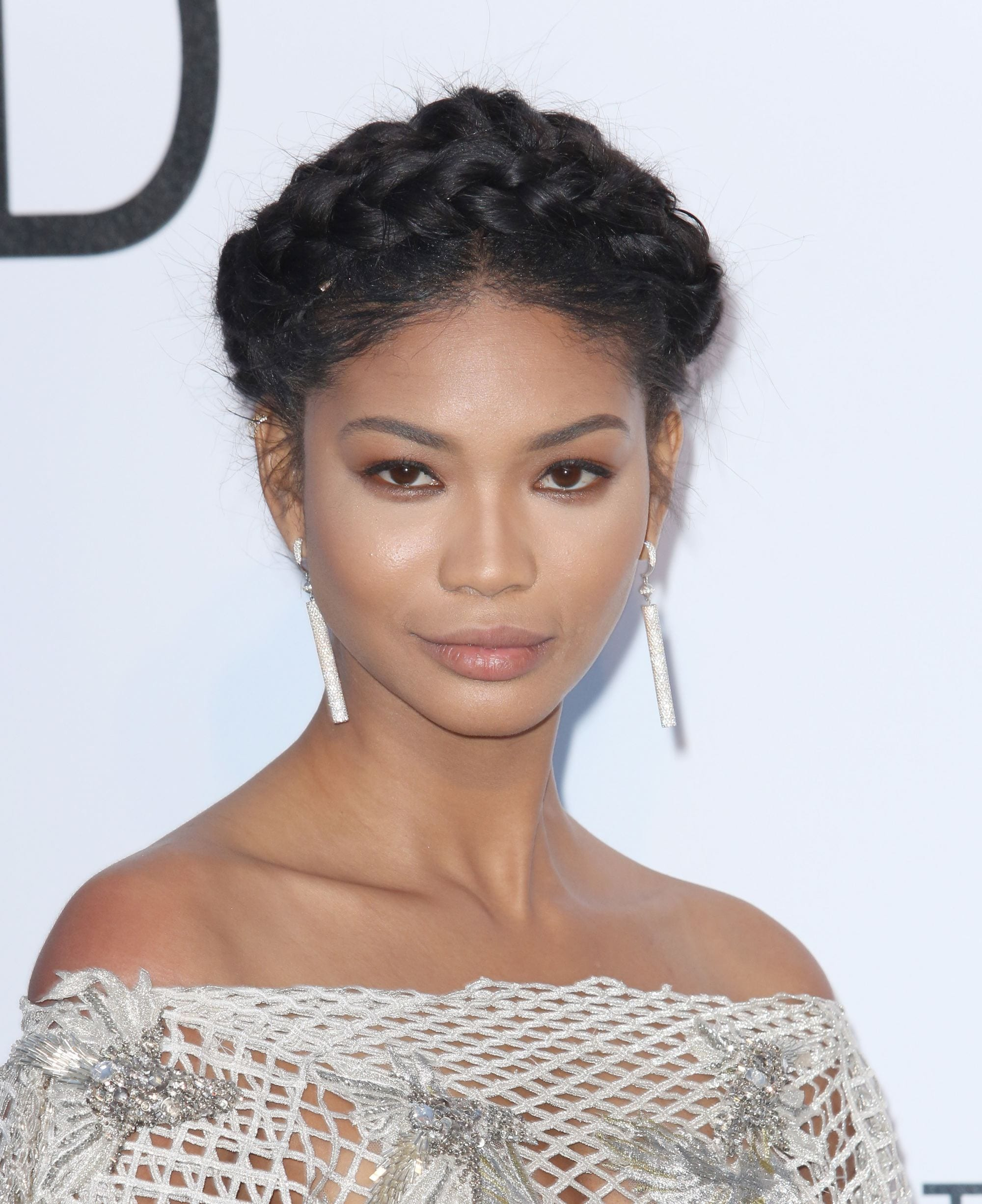 grecian hairstyles: close up shot of chanel iman with grecian inspired crown braid on the red carpet