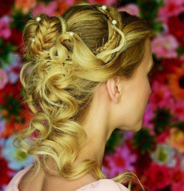side view of blonde hair in curly twisted half-up, half-down hairstyle