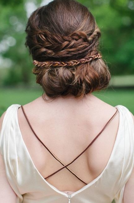 back view of brown hair in braided chignon updo