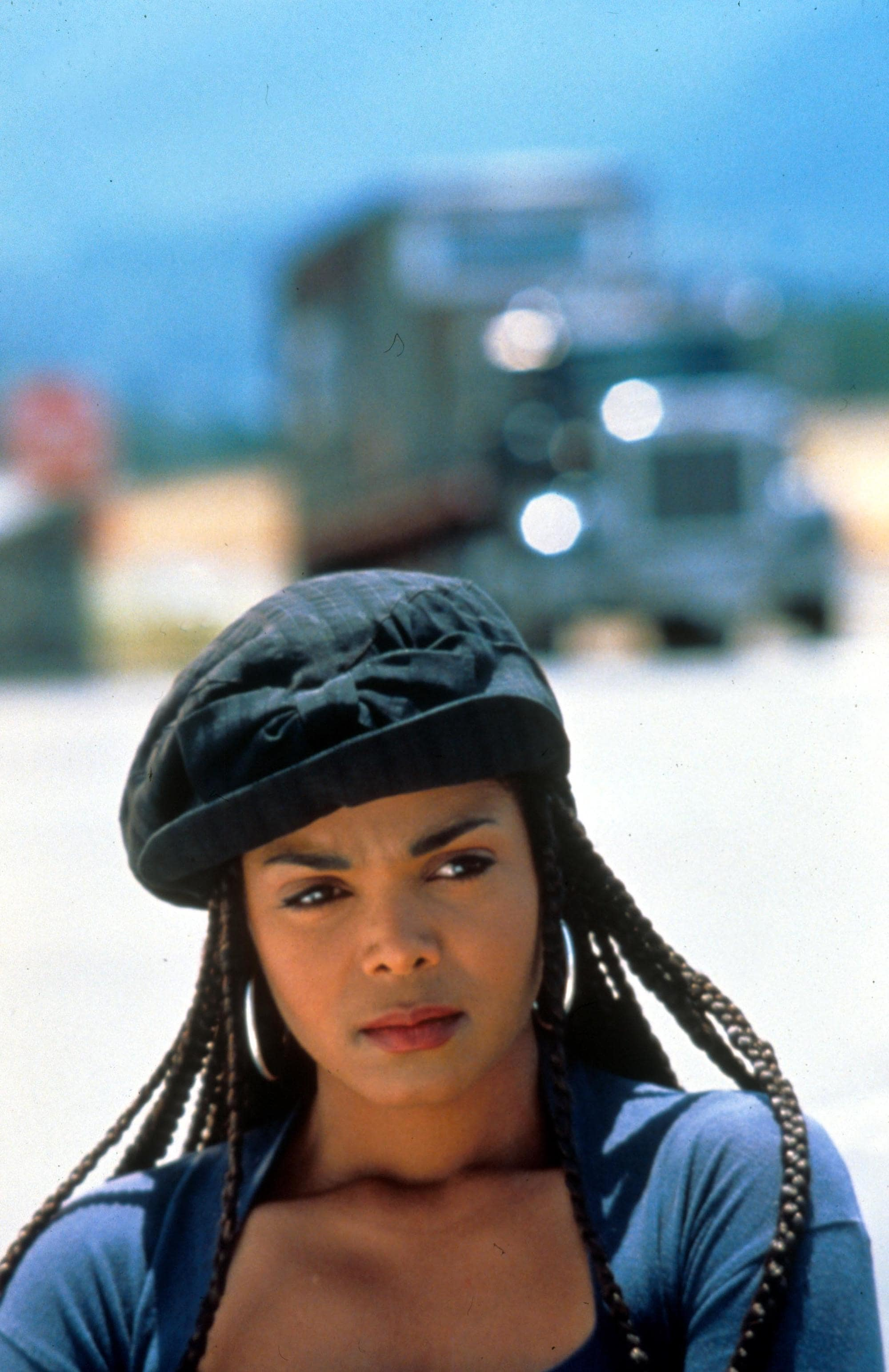 90s hairstyles: Janet Jackson box braids from Poetic Justice movie wearing a black beret and hoop earrings
