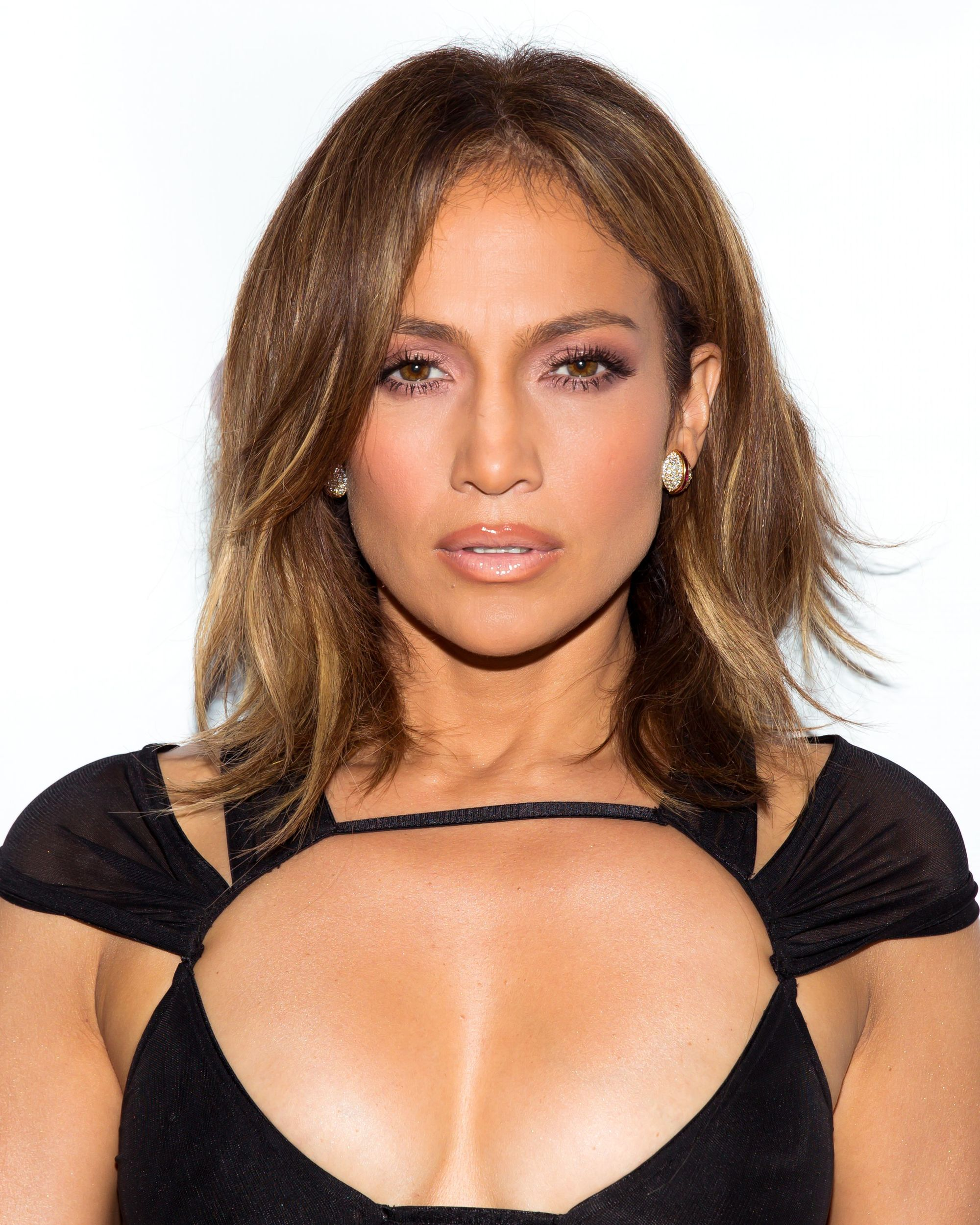 Rachel haircut: Jennifer Lopez medium toned brown hair in long bob with side parting and slight wave