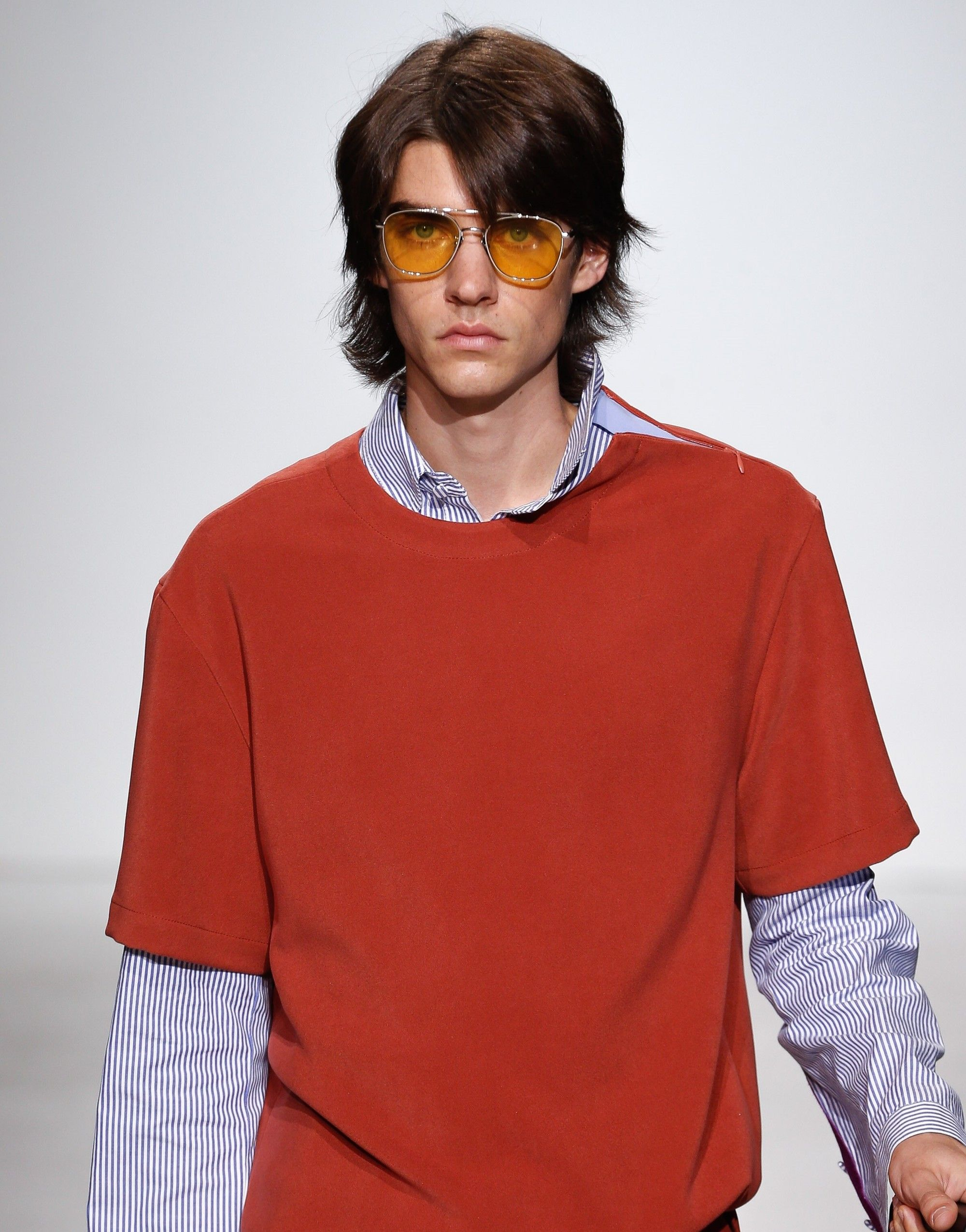 brunette male model with a 70s shag haircut