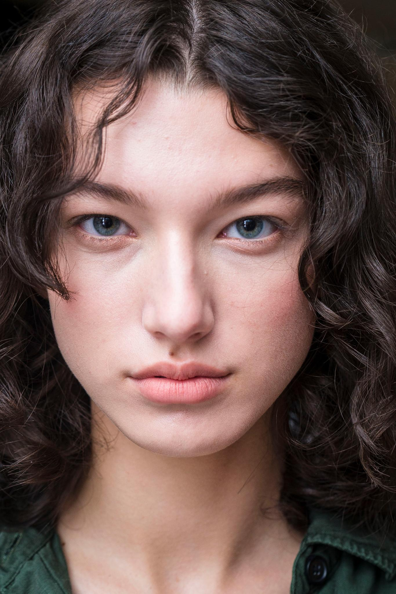 model with natural curly hair backstage