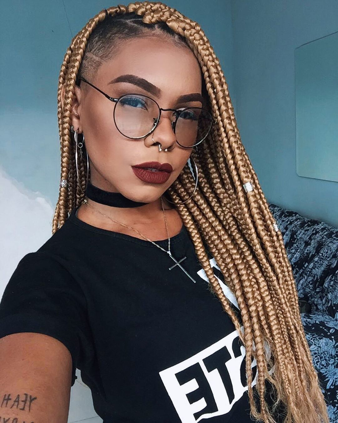 Woman long golden blonde box braids with subtle shaved sides