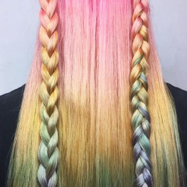 back view of pastel rainbow hair colour with two braids down straight hair