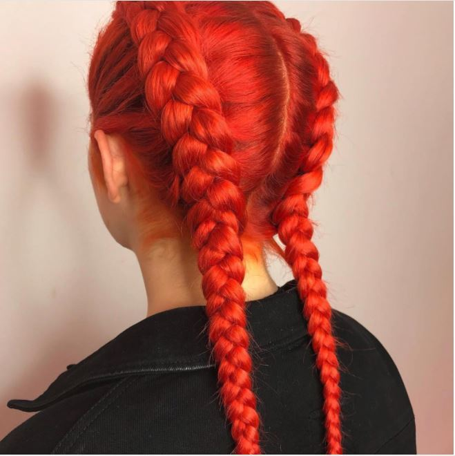 back view of bold red hue in double dutch braids