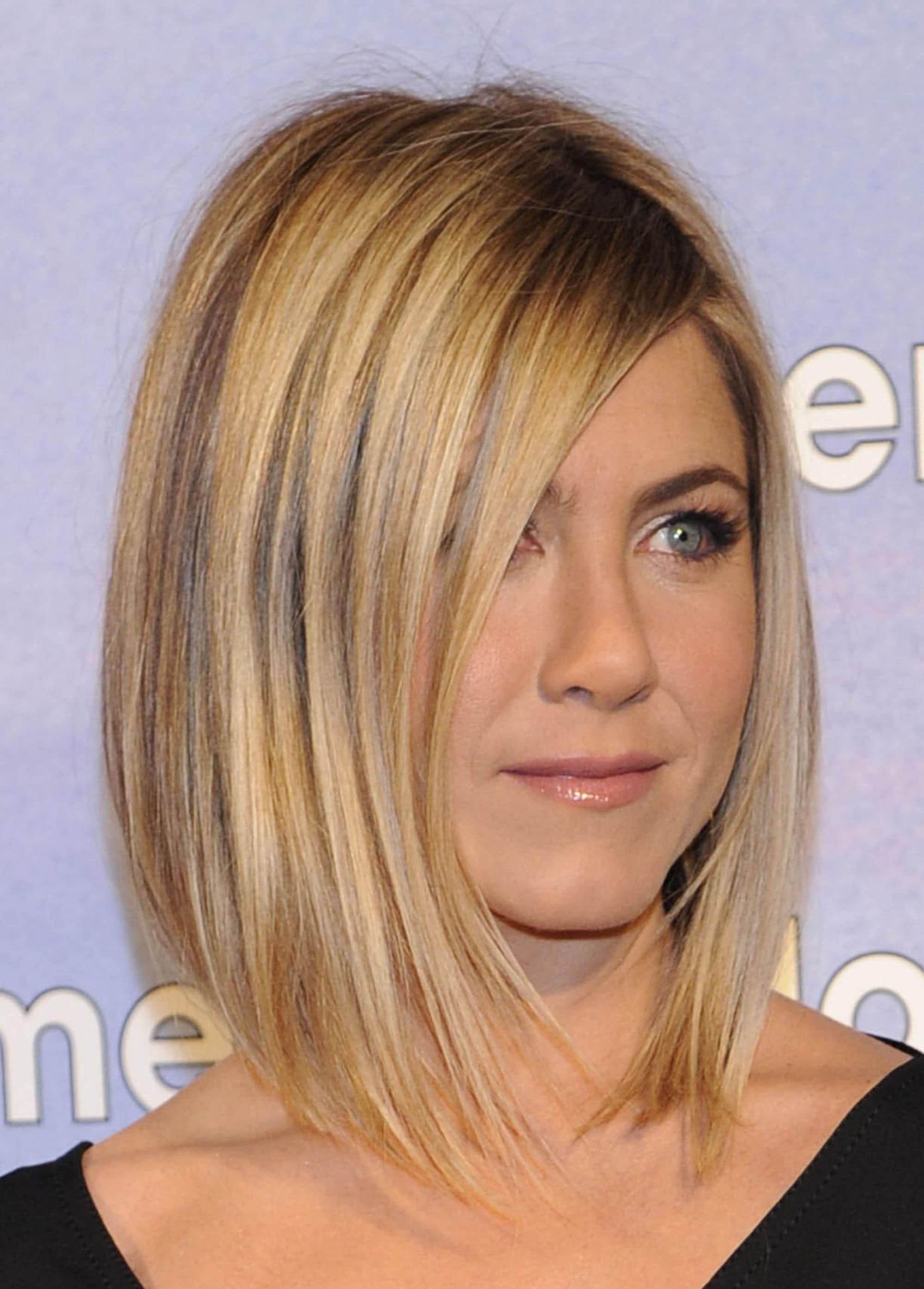 Jennifer Aniston golden blonde hair in straight asymmetrical bob