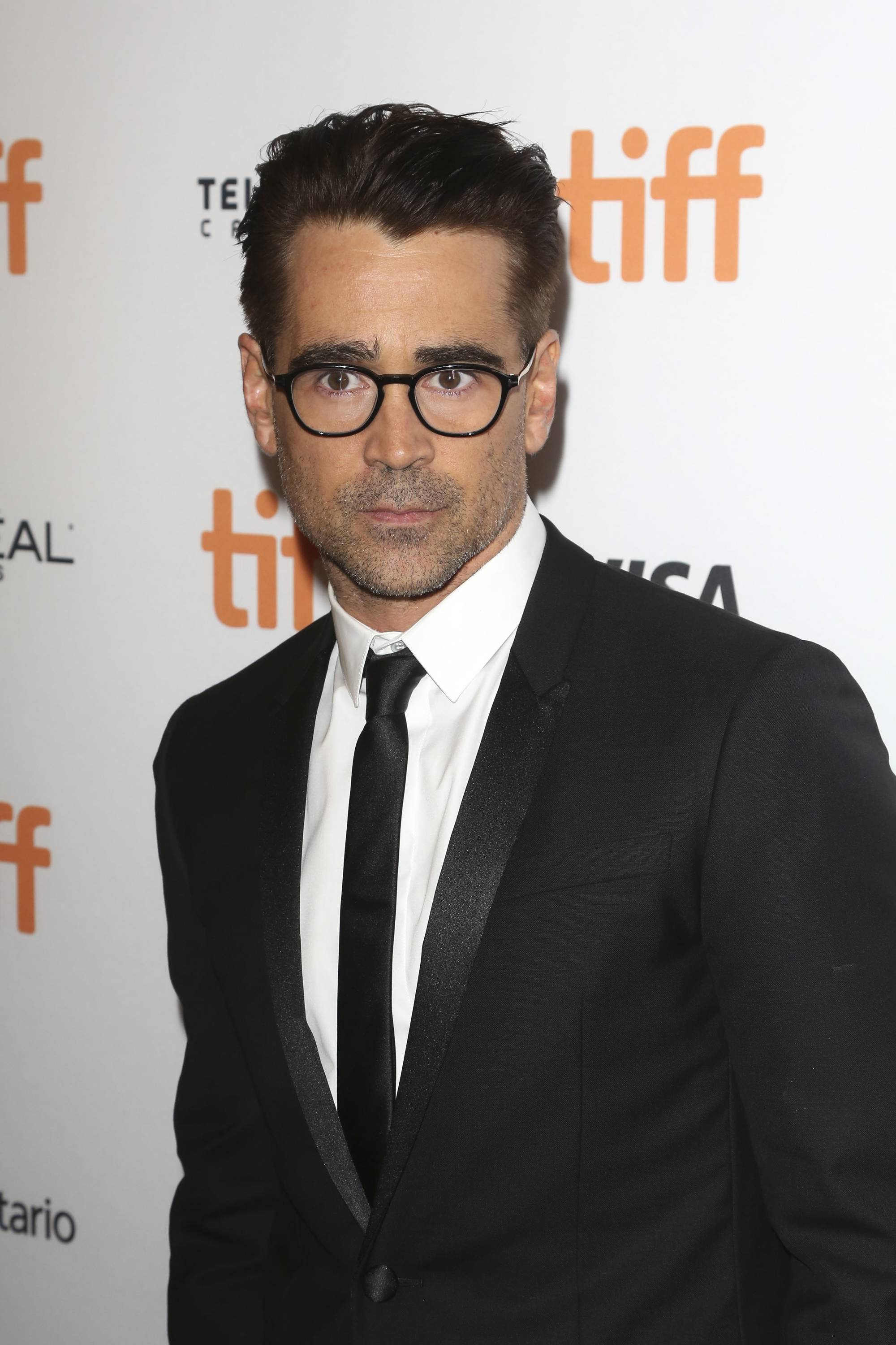 Colin Farrell swept back taper haircut on brown hair