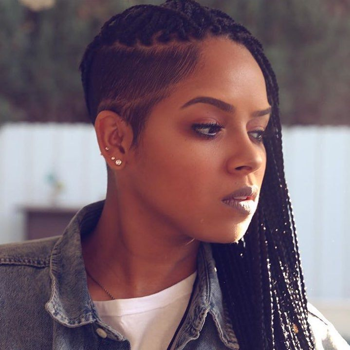 Woman with dark brown long box braids with