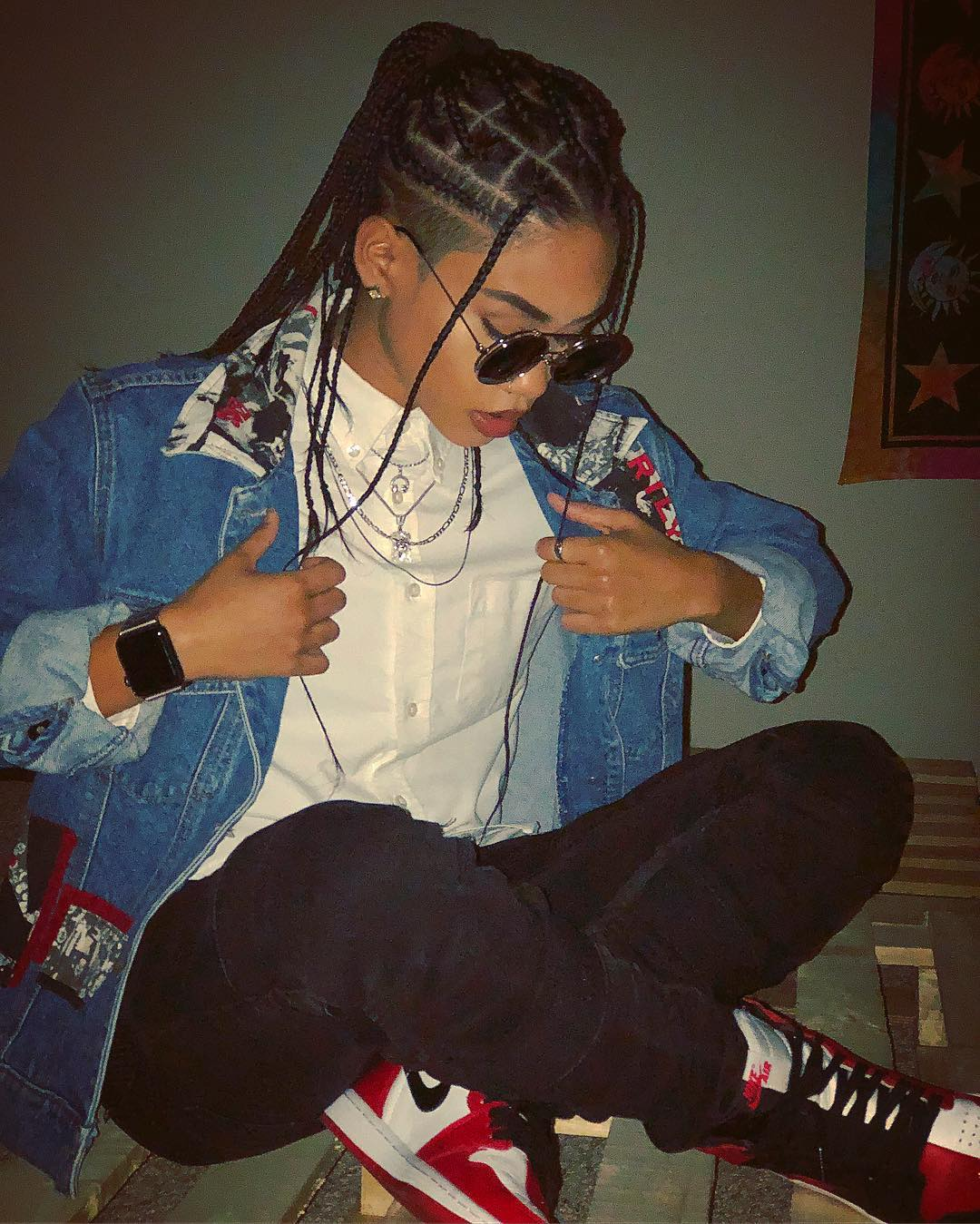 Woman with shaved sides with half up box braids
