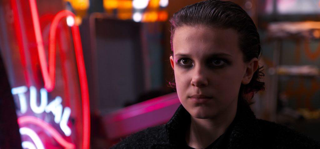 Stranger Things 2: Eleven with short slicked-back hair, wearing dark eye shadow