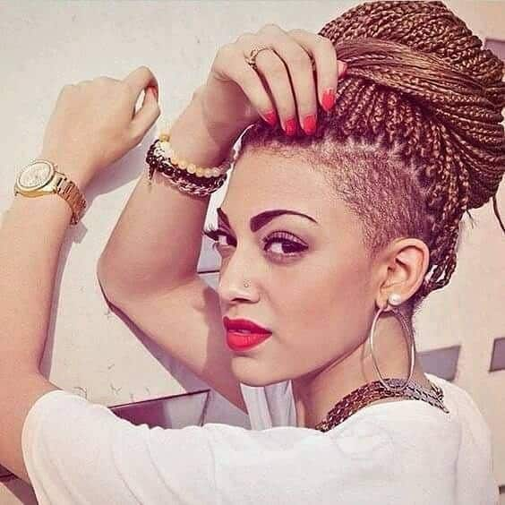 Woman with golden blonde box braids updo with shaved undercut