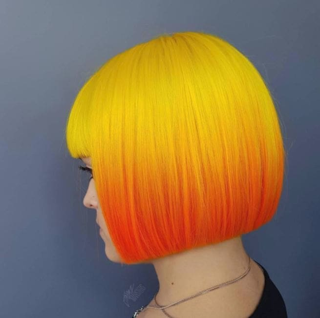 bold yellow to orange ombre hair colour on blunt bob length hair