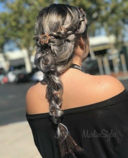 Witch hair: Back view of a woman with long grey hair in a medieval braided style