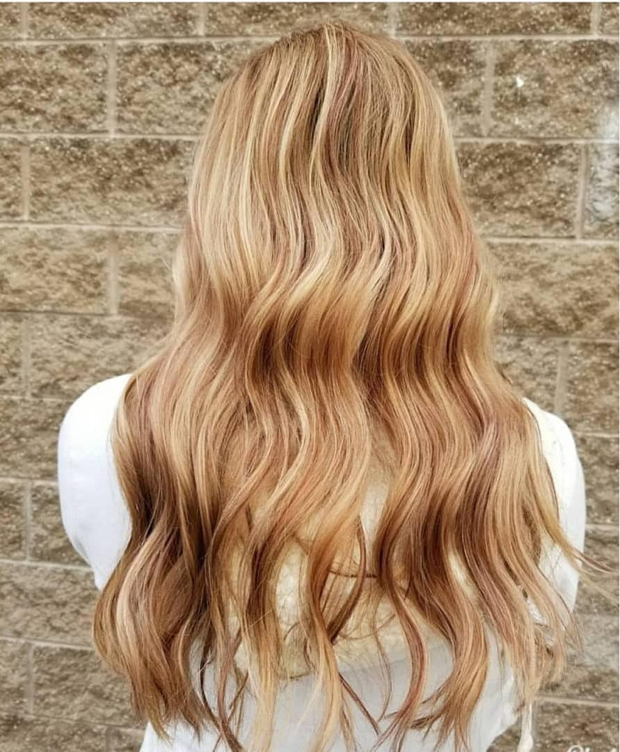 Woman with long copper honey blonde wavy hair