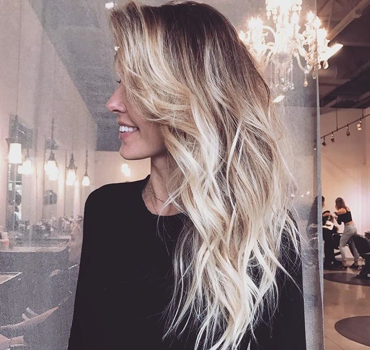 close up shot of audrina patridge at a hair salon with blonde blonde hair, wearing black jumper and showing off her new platinum blonde ombre hair