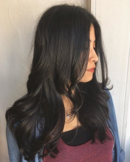 Club hairstyles: Asian woman with long dark blowout hair