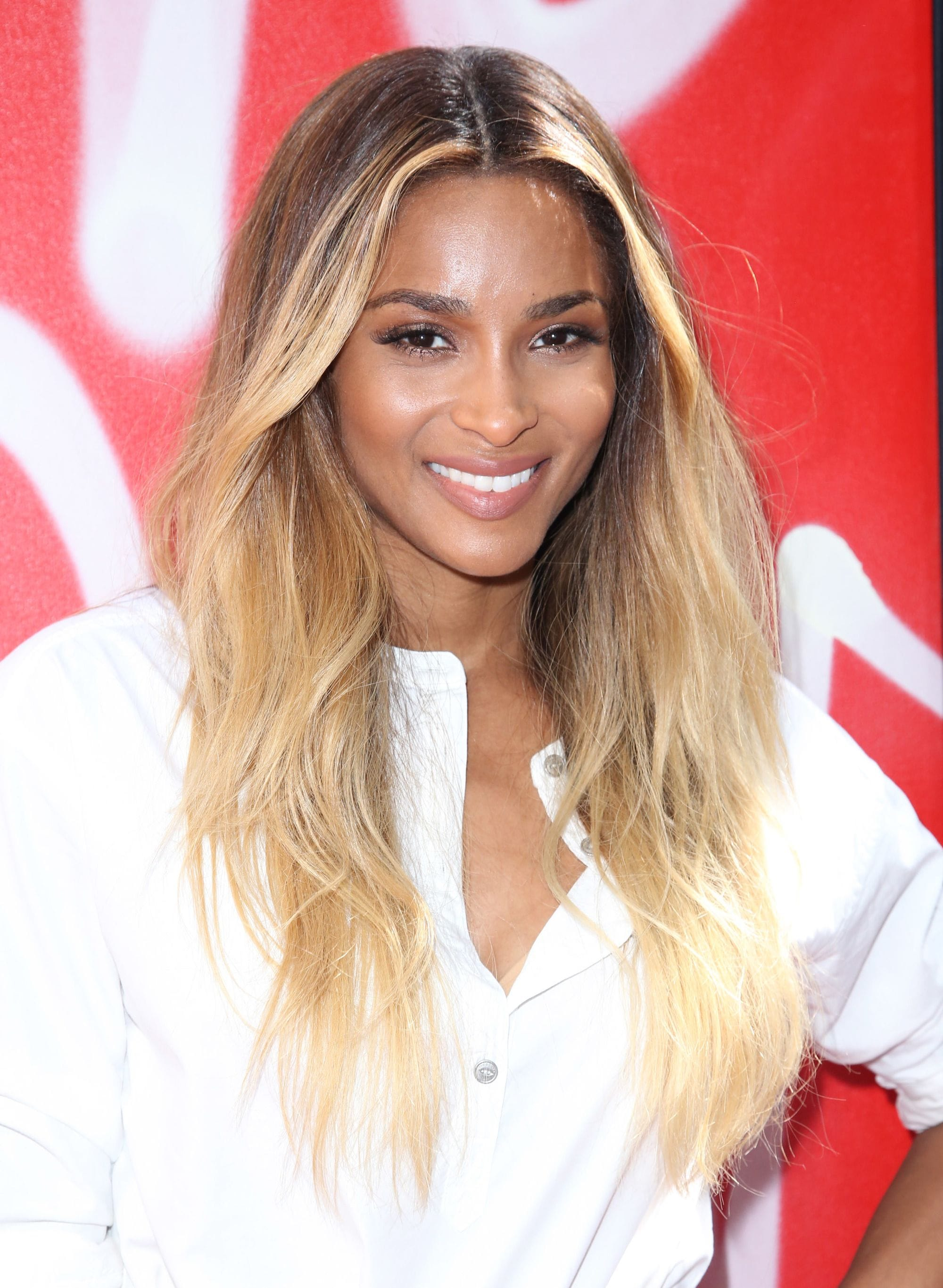 Blonde hair: Close up shot of Ciara with caramel blonde wavy hair.