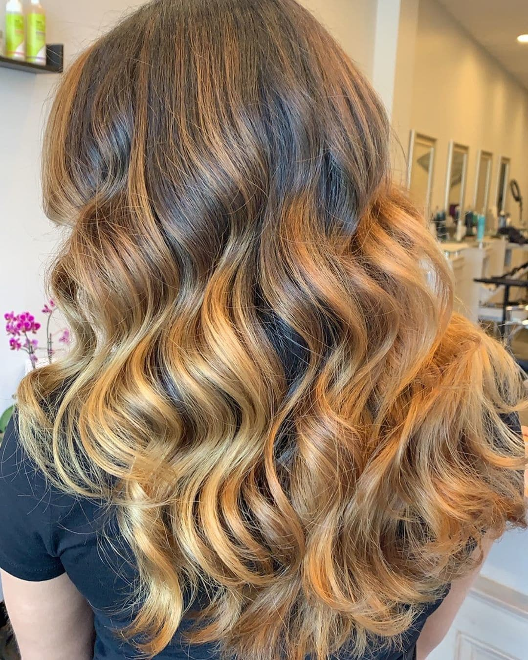 Woman with long wavy caramel honey blonde hair