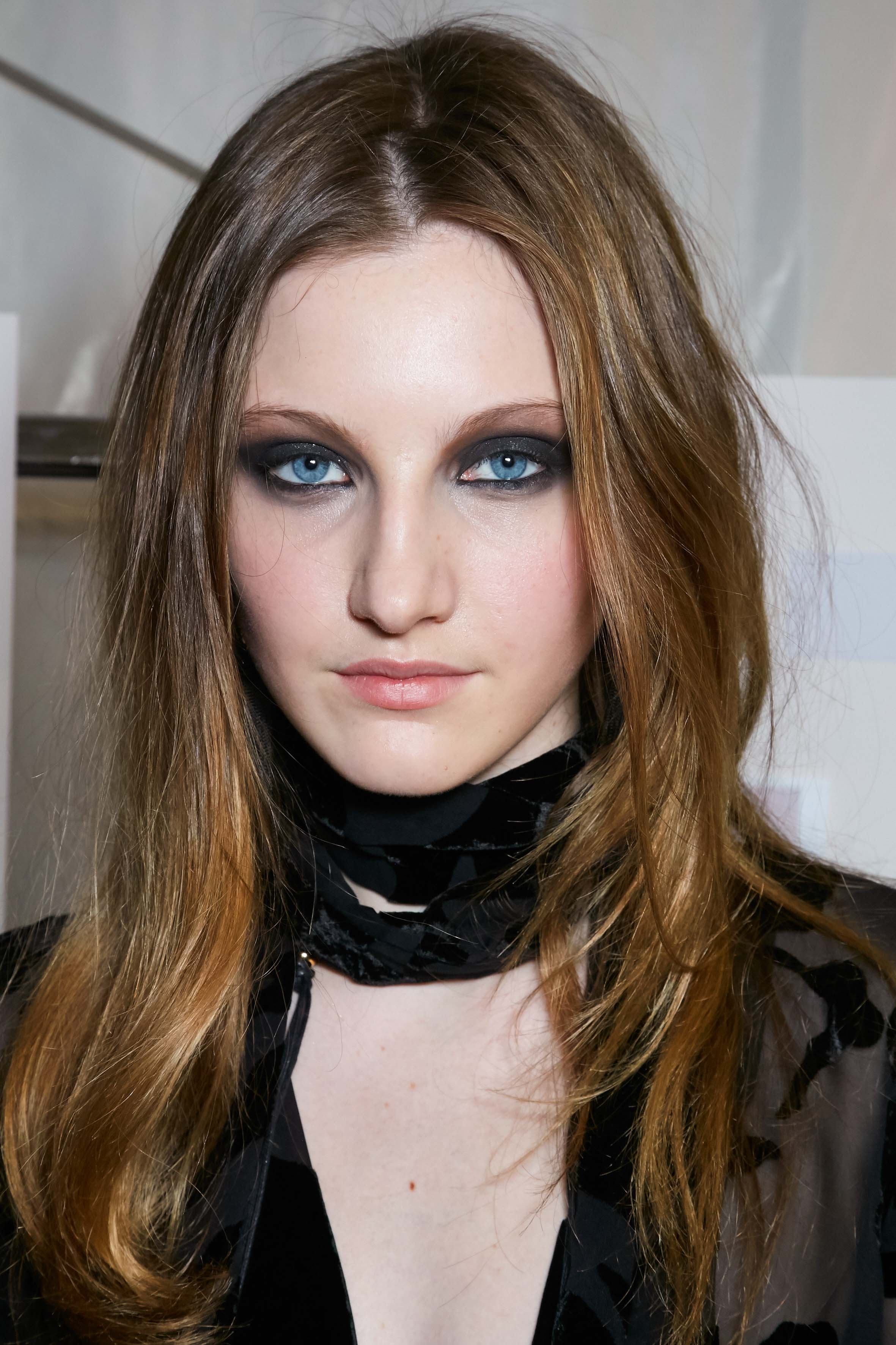 front view of model with brown auburn balayage medium length hair