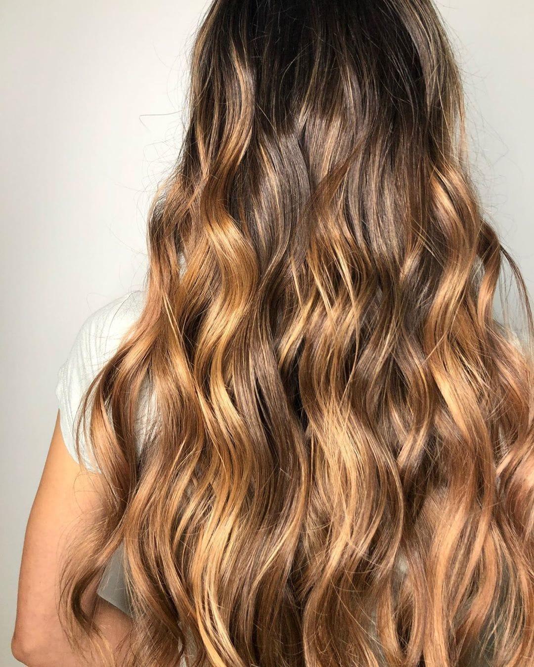 Woman with long dark honey blonde wavy hair