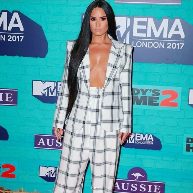 Front view of Demi Lovato's long black Rapunzel straight hair over one shoulder for the 2017 MTV EMAs