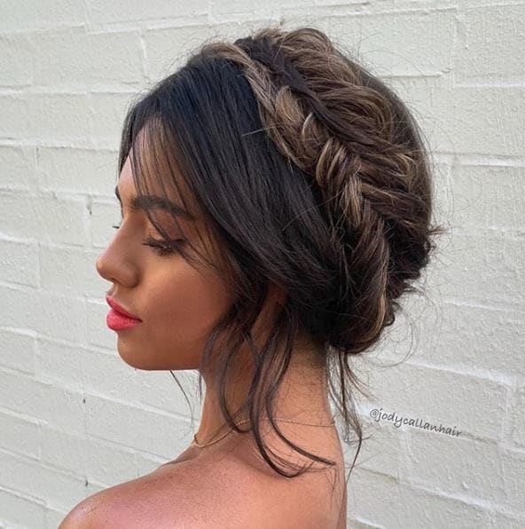 Fishtail braids: Woman with dark brown hair in halo fishtail braid.