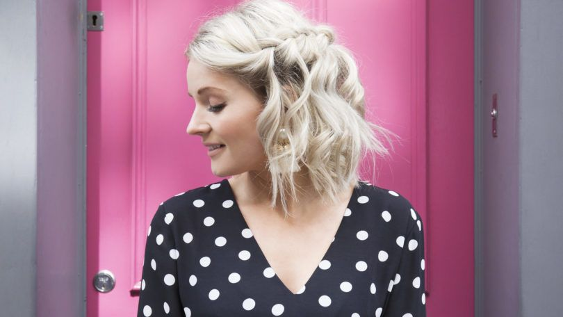 Blonde with a short wavy bob in a waterfall braid