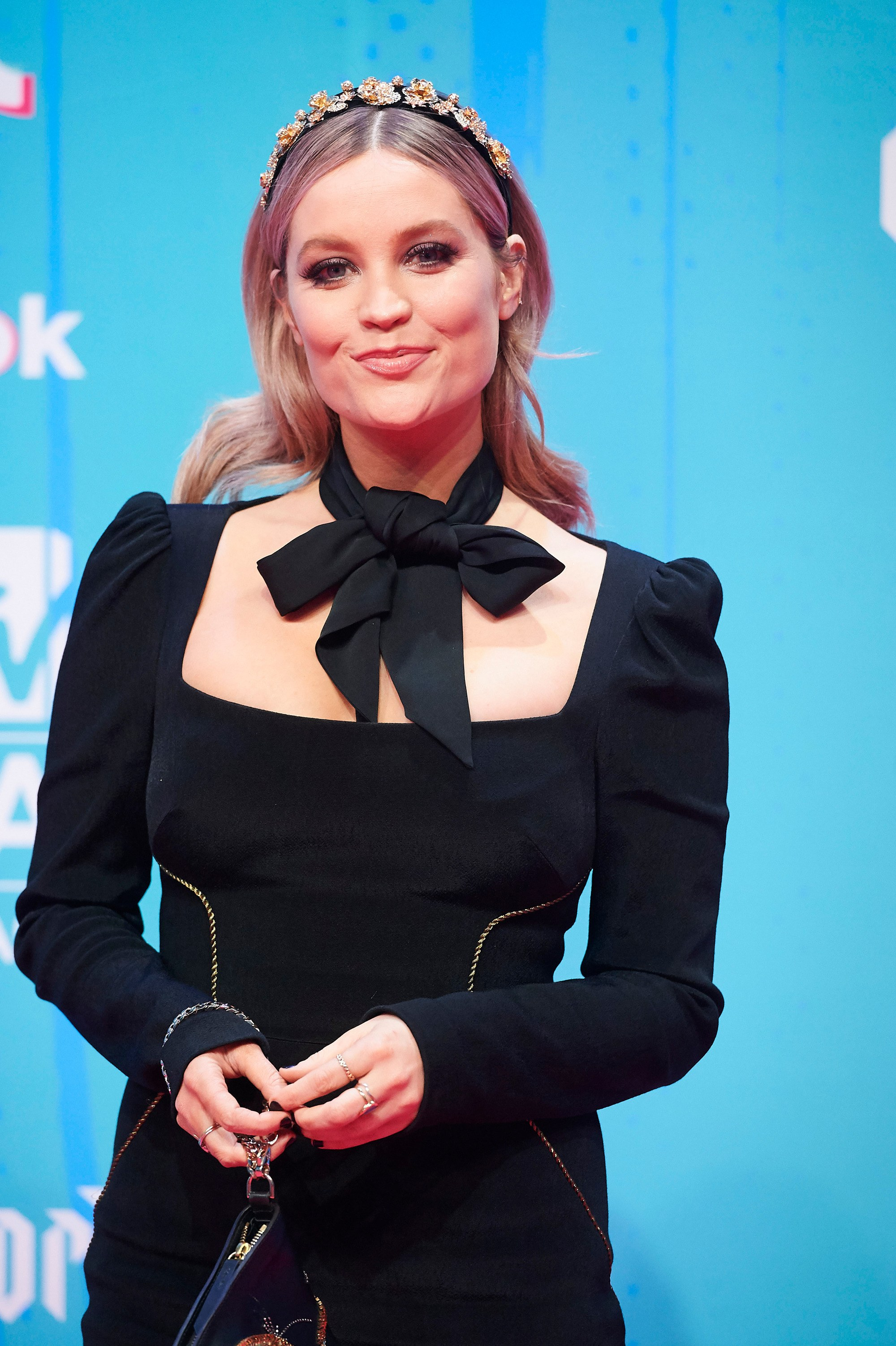 MTV EMAs 2018: MTV presenter Laura Whitmore at the 2018 EMAs wearing a jeweled headband and black velvet dress