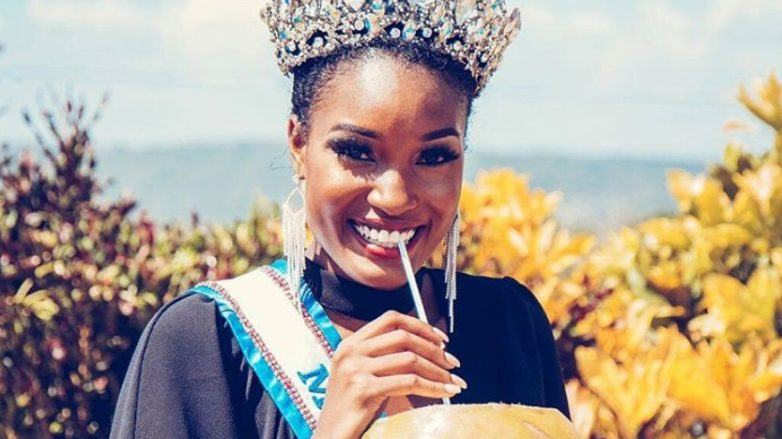 close up shot of miss jamaica's davina bennet, wearing crown and miss universe sash, with coconut